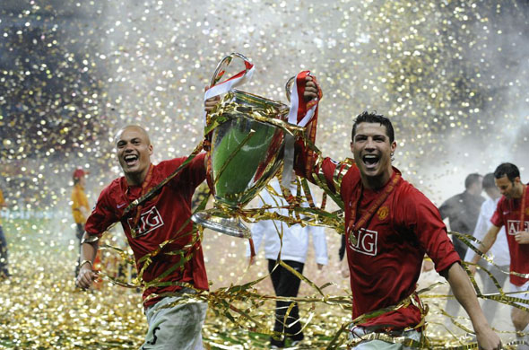 Wes Brown And Cristiano Ronaldo Lifting The 2008 Champions League Trophy In Moscow
